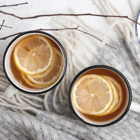Hot drink with lemon slices