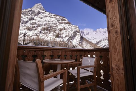 Mountainous landforms, Mountain, Room, Snow, Winter, Sky, Tree, Log cabin, Table, Mountain range,