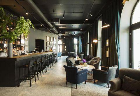 Lighting, Interior design, Floor, Room, Living room, Furniture, Ceiling, Couch, Interior design, Light fixture,