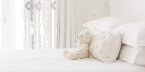 White, Bed sheet, Teddy bear, Stuffed toy, Product, Room, Textile, Bedding, Toy, Furniture,