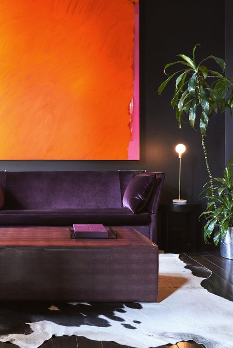 Furniture, Living room, Room, Interior design, Couch, Orange, Lighting, Purple, Wall, Floor,