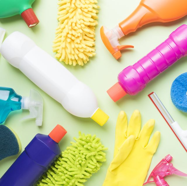 House cleaning product on green background