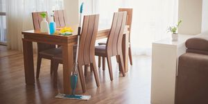 House cleaning supplies in dining room