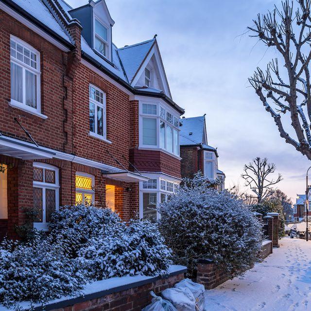winter sunrise in snowy suburb in london, uk