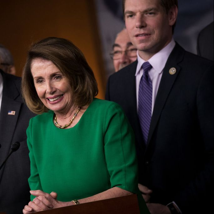 California Congressman Eric Swalwell (right) stands behind House Speaker Nancy Pelosi in 2017. Swalwell is running for the Democratic nomination for president on a platform of gun control.