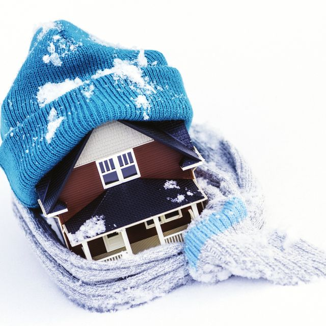 house wrapped in winter clothing insulate your home