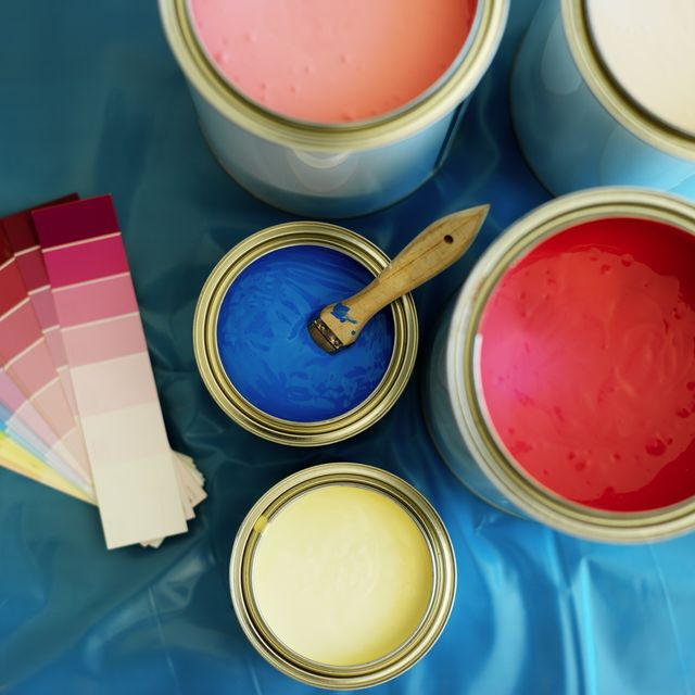 elevated view of pots of red blue pink yellow and white paint