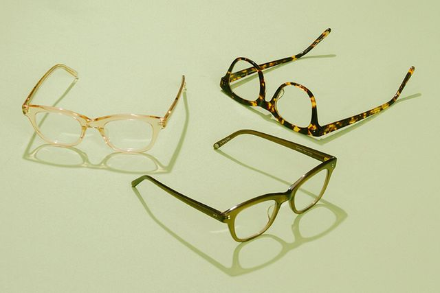 glasses on green background