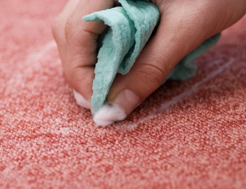 cleaning a red rug