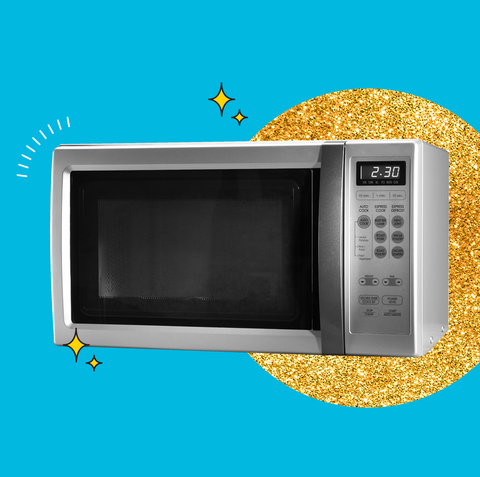 a silver microwave on a blue background