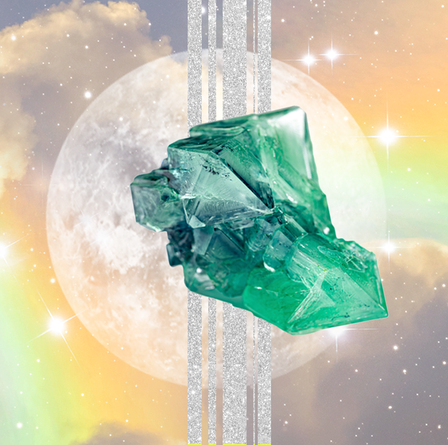 a green crystal is placed in front of a full moon with silver lines behind it and a background of a cloudy rainbow sky