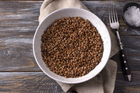 bowl of lentils on wood with napkin