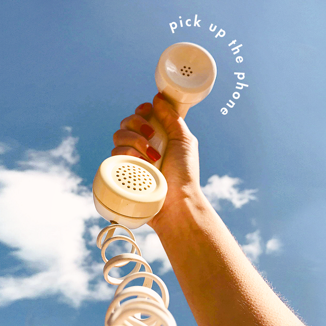 """a phone held to the blue sky with the text """"pick up the phone"""""""