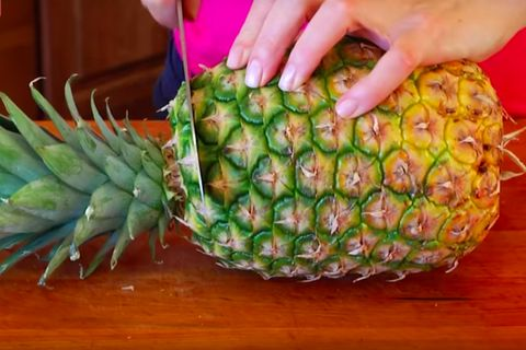 How To Cut A Pineapple Easily Cutting Up A Pineapple In 4 Steps