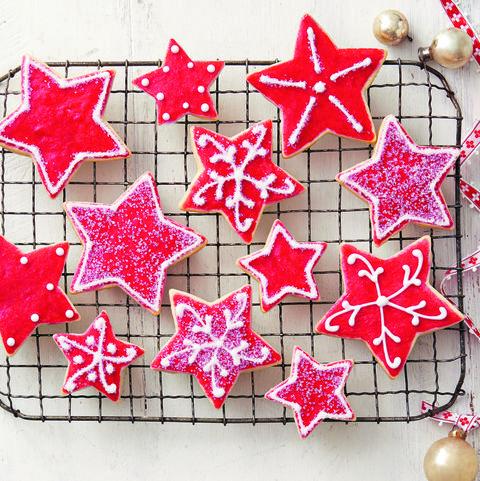 red sugar cookie stars on wire rack