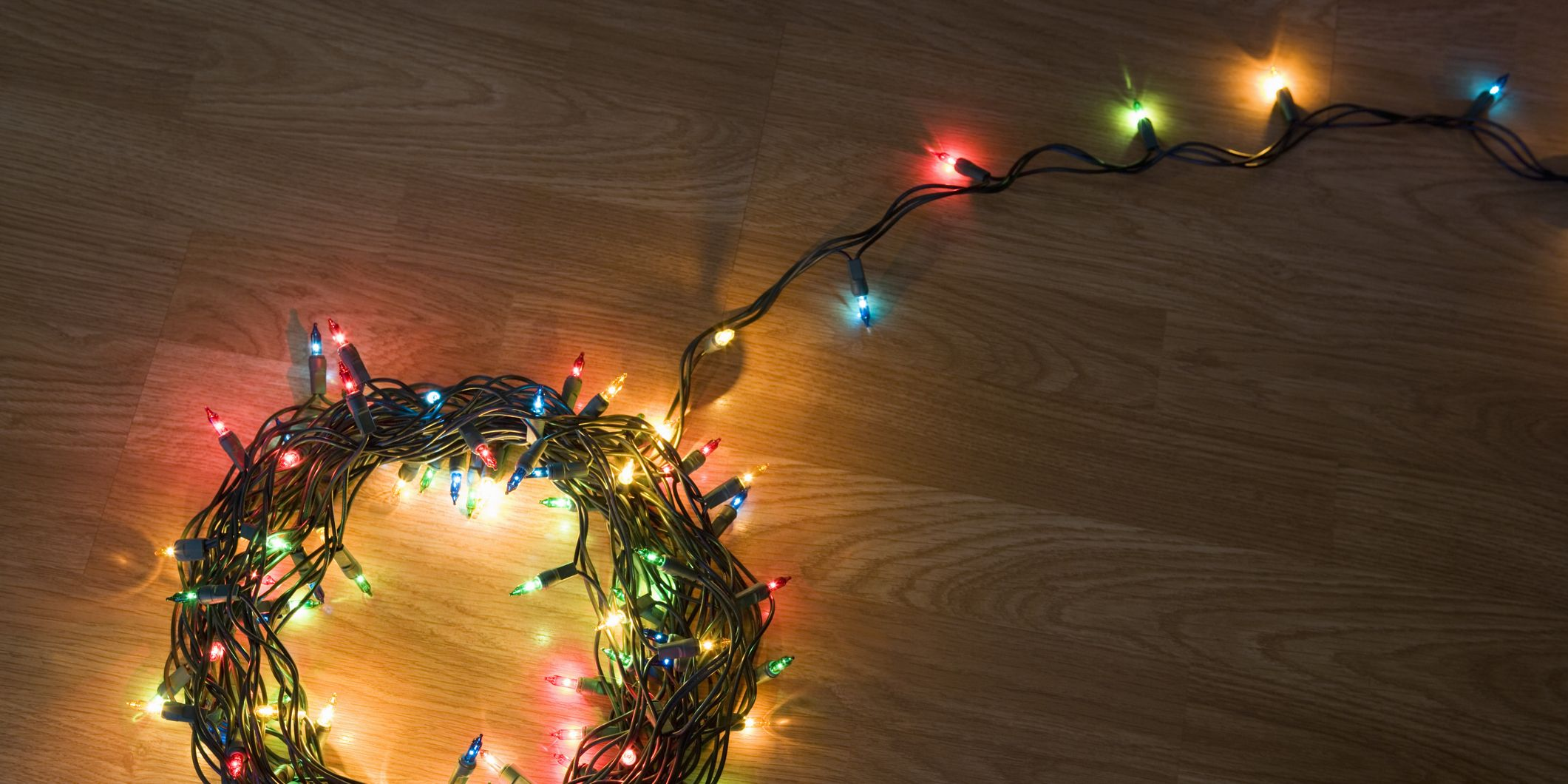 Coil of light christmas lights lying on floor, elevated view