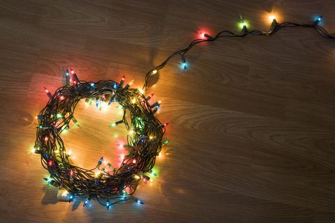 coil of light christmas lights lying on floor elevated view getty imagesbryan mullennix youve probably been stringing - Best Way To String Lights On A Christmas Tree