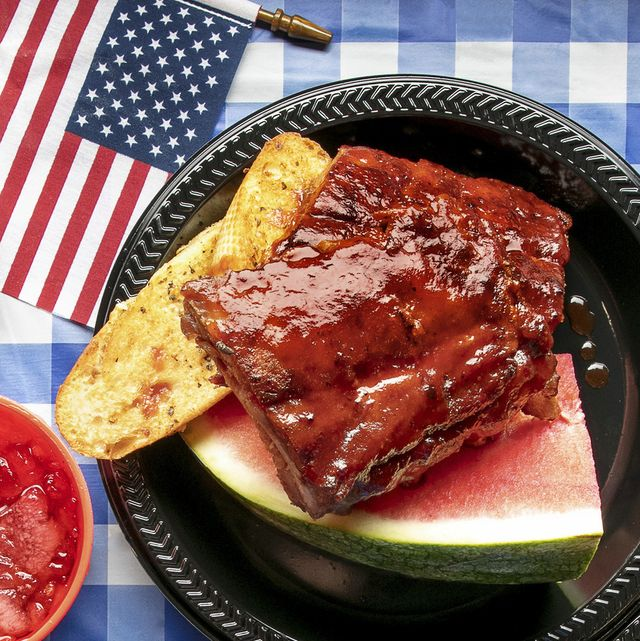 sweet and smoky ribs with barbecue sauce and watermelon with american flag