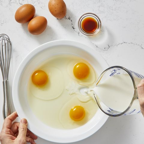 eggs and milk mixed together in a pan