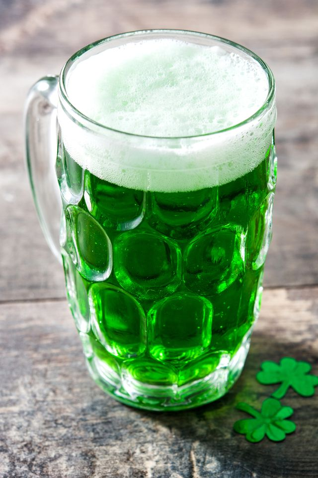 traditional cold green beer for saint patricks day,  on wooden table
