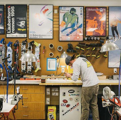man waxing his skis