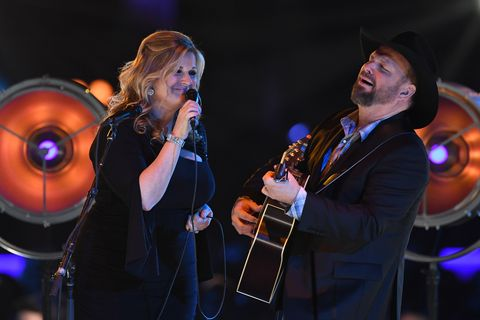 us singer trisha yearwood l and us singer garth brooks perform onstage at the 2019 musicares person of the year gala at the los angeles convention center in los angeles on february 8, 2019   the 2019 musicares honor us singer songwriter dolly parton as the person of the year photo by valerie macon  afp        photo credit should read valerie maconafp via getty images