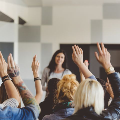 Student voting on seminar, raising hands