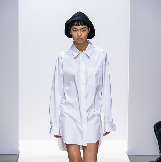 Clothing, Sleeve, Shoulder, Fashion show, Joint, Outerwear, Human leg, Fashion model, Style, Runway,