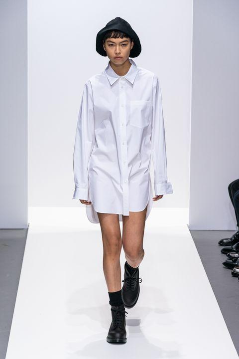 Fashion model, Fashion, Fashion show, Clothing, Runway, White, Shoulder, Footwear, Fashion design, Human,