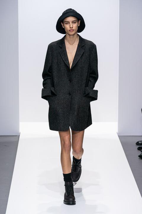Fashion model, Fashion show, Fashion, Runway, Clothing, Outerwear, Shoulder, Human, Footwear, Coat,