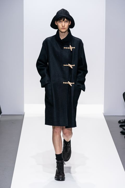Fashion model, Fashion show, Runway, Fashion, Clothing, Overcoat, Outerwear, Fashion design, Joint, Coat,