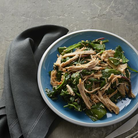 low-carb lunches: slow-cooked pork roast over sauteed mixed greens