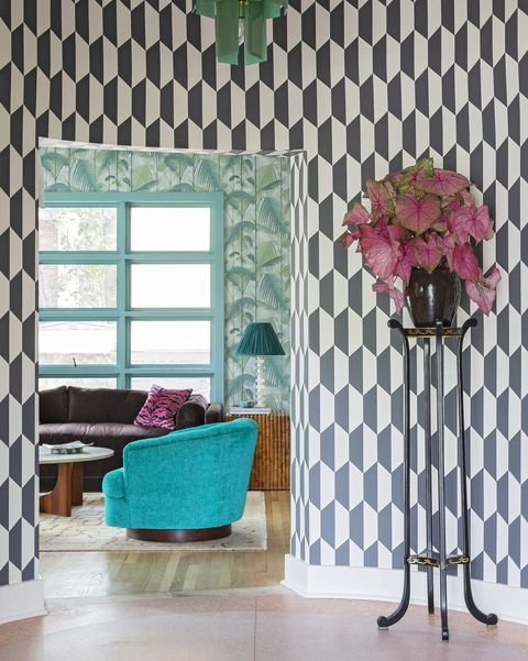 entryway into house, black and white geometric wallpaper with black coat rack