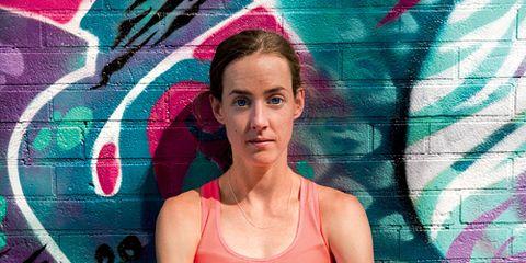 Molly Huddle against graffiti wall