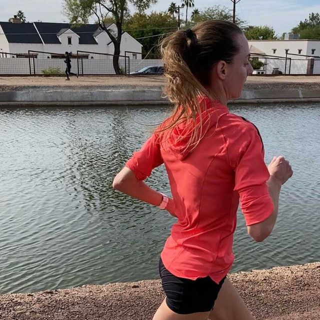 molly huddle running by canal