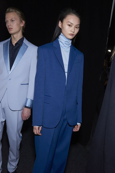 Suit, Formal wear, Clothing, Tuxedo, Pantsuit, Fashion, Cobalt blue, White-collar worker, Blazer, Outerwear,