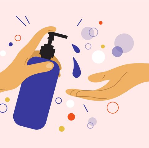 human hand holds dispenser with sanitizer gel or liquid soap