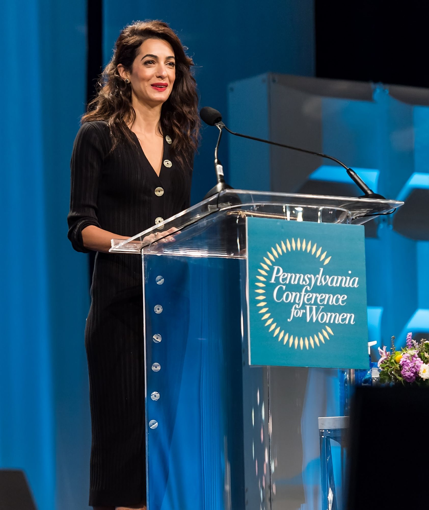 Amal attended the Pennsylvania Conference for Women 2018 wearing a black sweater dress.