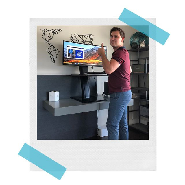 brandon in front of humanscale standing desk