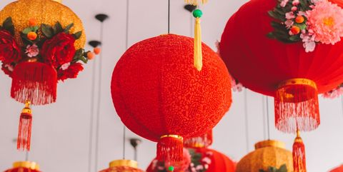 hanging red lanterns with tassels and faux flowers