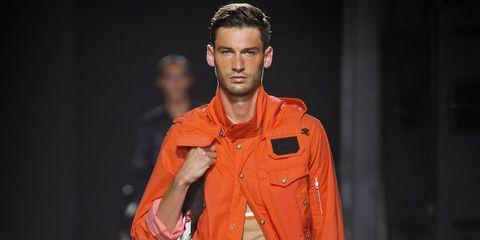Orange, Fashion, Fashion model, Yellow, Cheek, Forehead, Human, Model, Runway, Fashion show,
