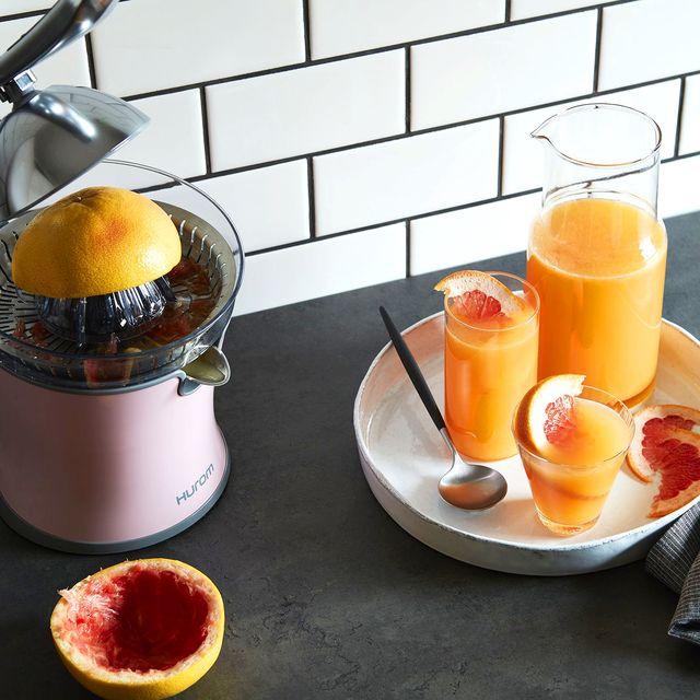 pink hurom citrus juicer with grapefruit juice