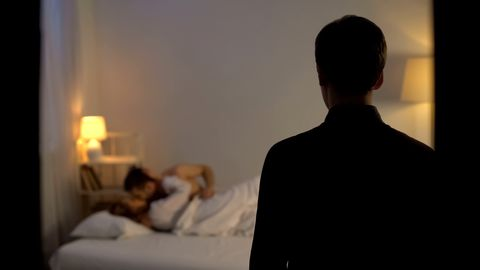 Husband catching his wife cheating with lover in bed, finding out adultery