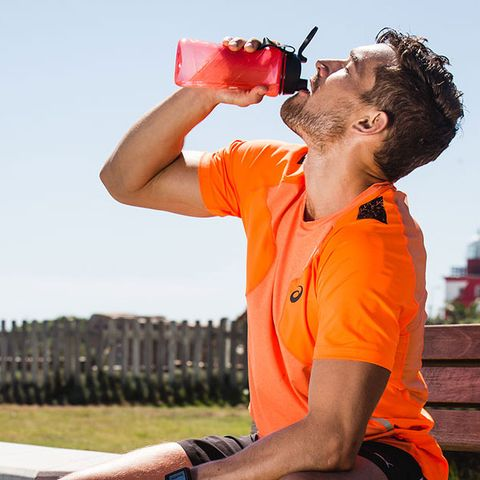 man drinking from sports bottle