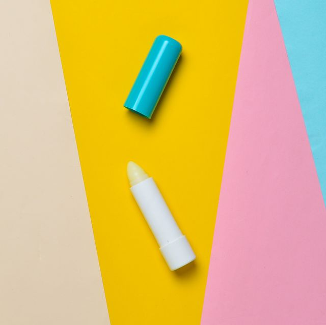 hygienic lip balm on a colored paper background, minimalism, top view