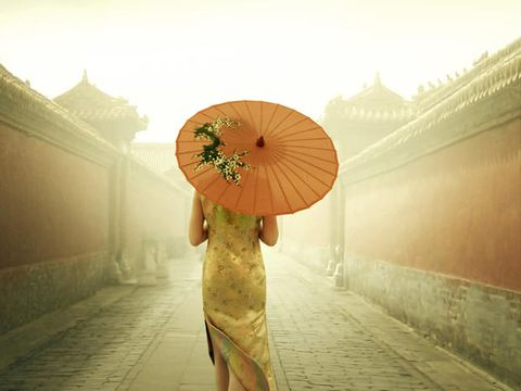 Yellow, Photograph, Standing, Atmospheric phenomenon, Amber, Light, Sunlight, People in nature, Temple, Orange,