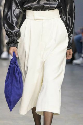 Clothing, White, Fashion, Fashion model, Waist, Leg, Footwear, Human leg, Haute couture, Fashion show,