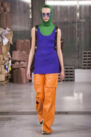 Fashion model, Fashion, Fashion show, Clothing, Orange, Runway, Yellow, Electric blue, Haute couture, Fashion design,