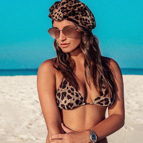 Bikini, Clothing, Swimsuit top, Swimwear, Swimsuit bottom, Beauty, Skin, Summer, Sun tanning, Vacation,