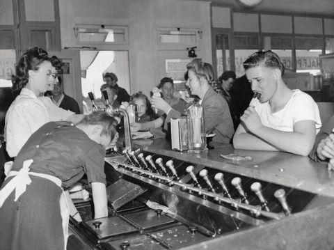 people having ice cream sodas in parlor